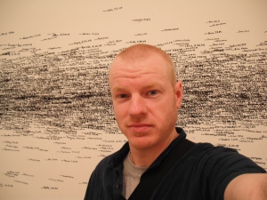 "at MoMA, in the ""mark your height"" room."